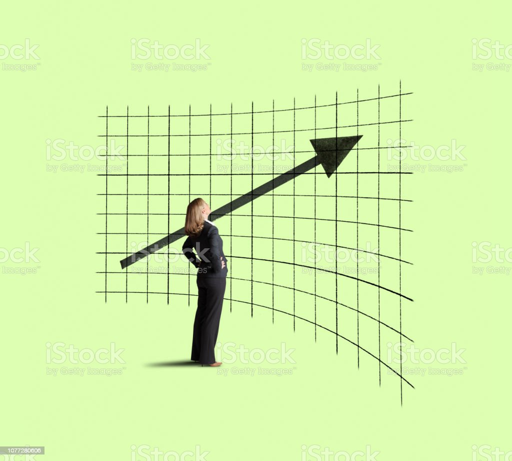 Businesswoman Looking Up At Improving Trend stock photo