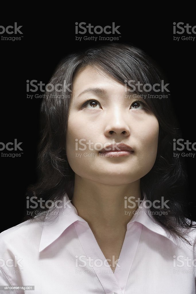 Businesswoman looking up, close-up royalty-free stock photo
