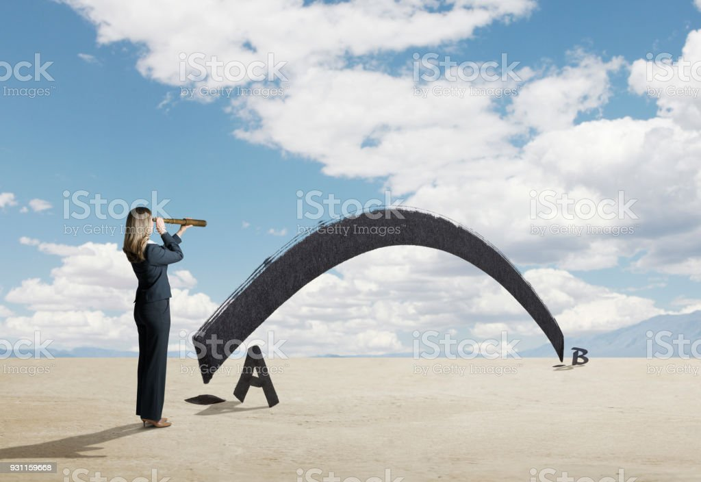 Businesswoman Looks Through Spyglass For Shortest Distance Between Two Points stock photo