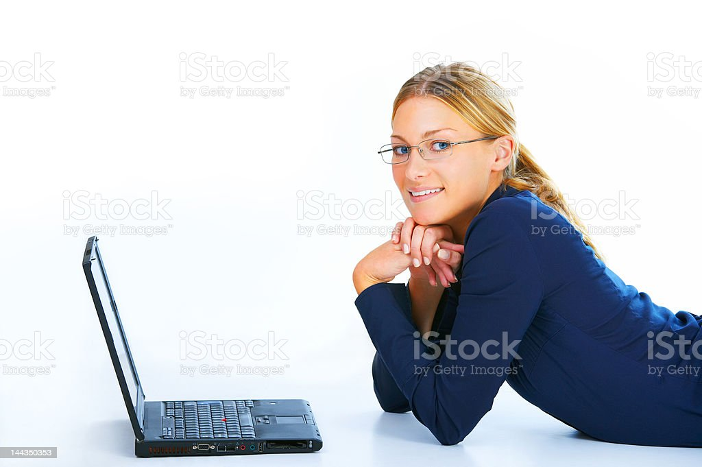 Businesswoman lying in front of a laptop royalty-free stock photo
