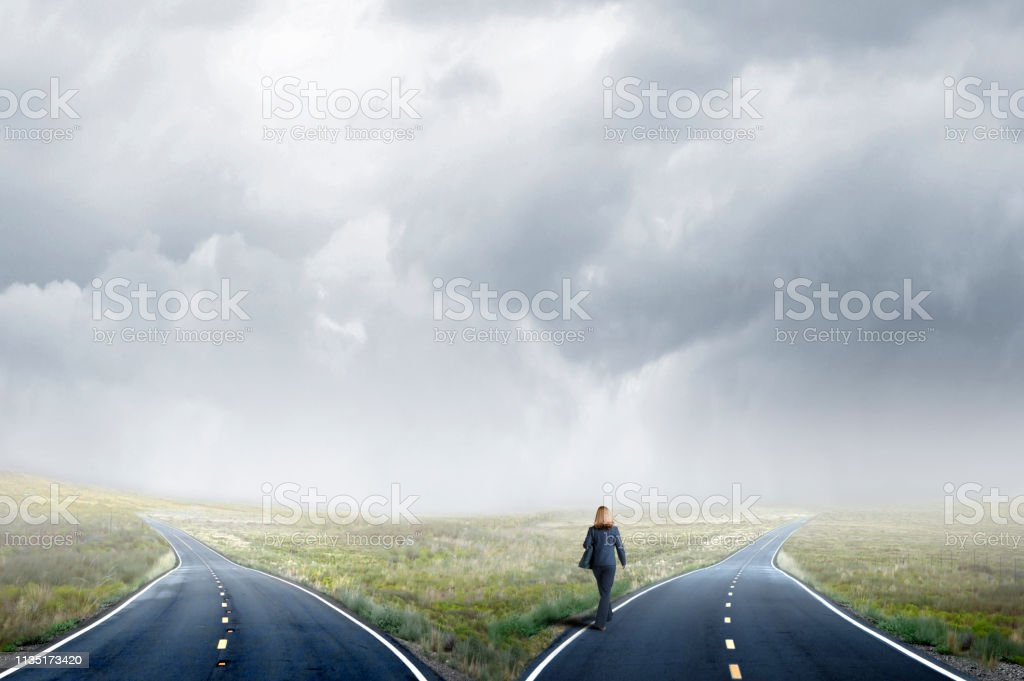Businesswoman Makes A Decision At A Fork In The Road stock photo