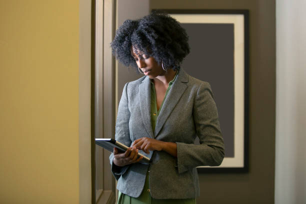 Businesswoman Making a Business Plan with a Tablet stock photo