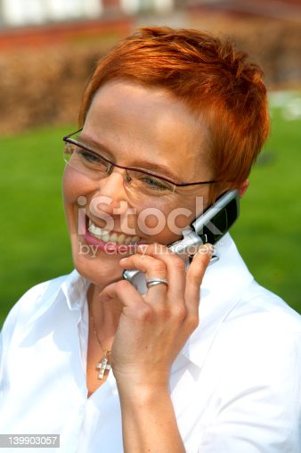 1150572074istockphoto Businesswoman making a phone call. 139903057