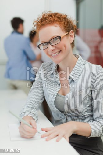 istock Businesswoman making notes in meeting 148198197