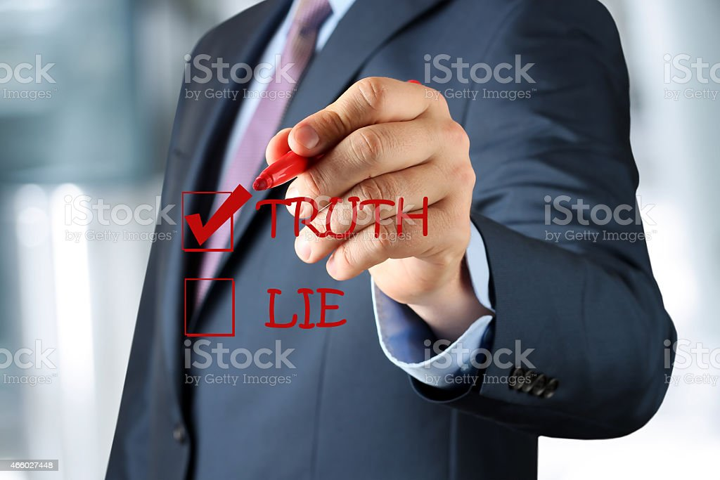 Businesswoman  making  one's choice between truth or lie stock photo