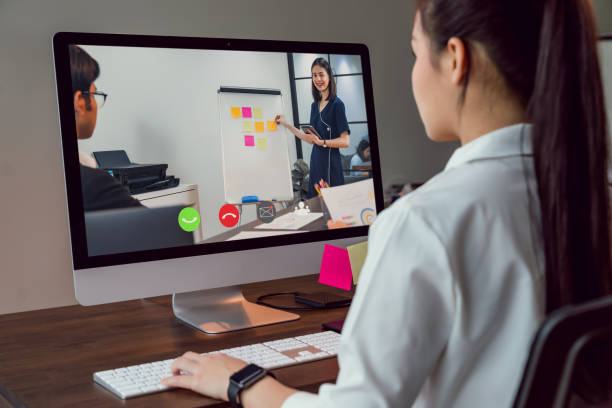 Businesswoman making video call meeting to team online and present work projects. stock photo