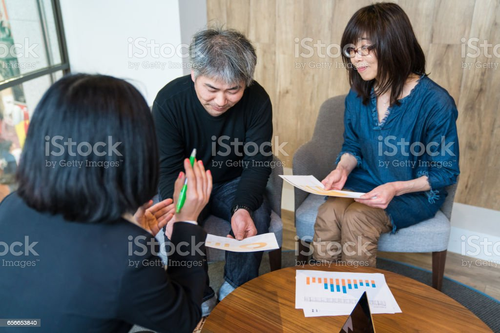 Businesswoman meeting with a mature couple stock photo