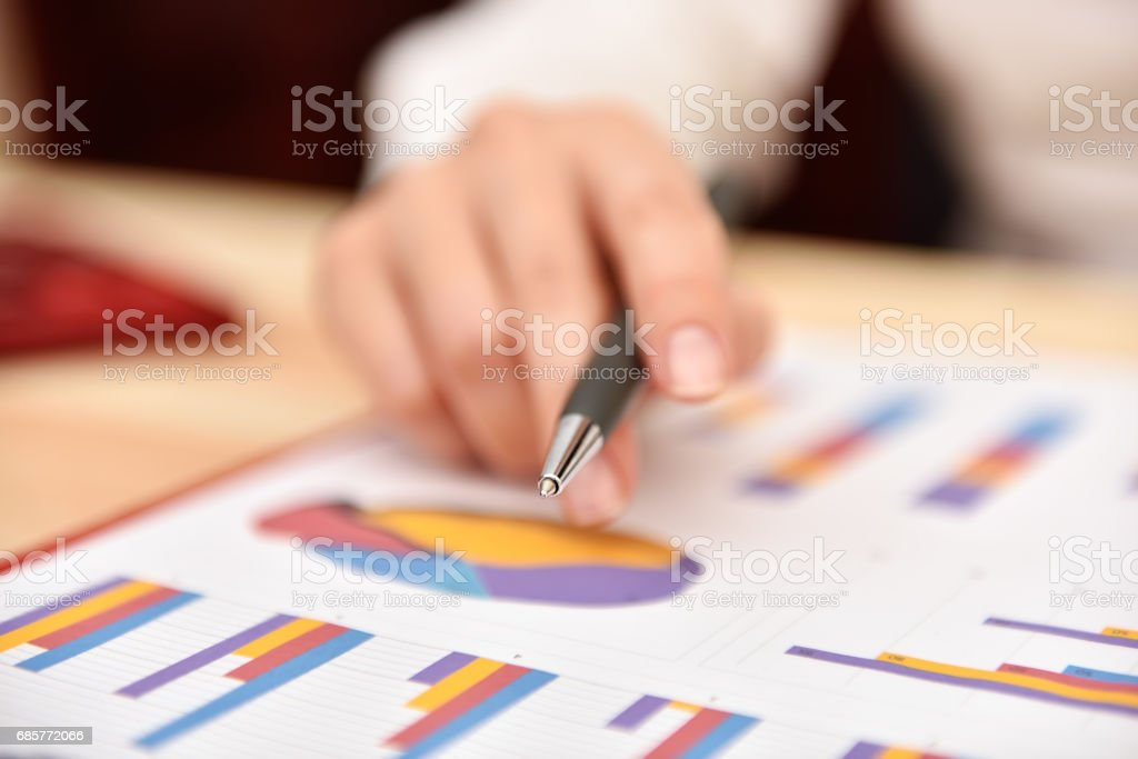 Businesswoman Monitoring Stock Statistics royalty-free stock photo