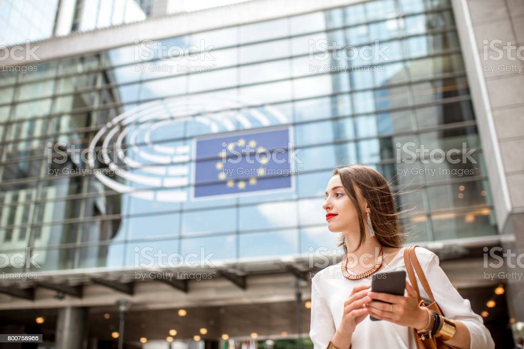 Businesswoman near the parliament building in Brussel - Royalty-free Adult Stock Photo
