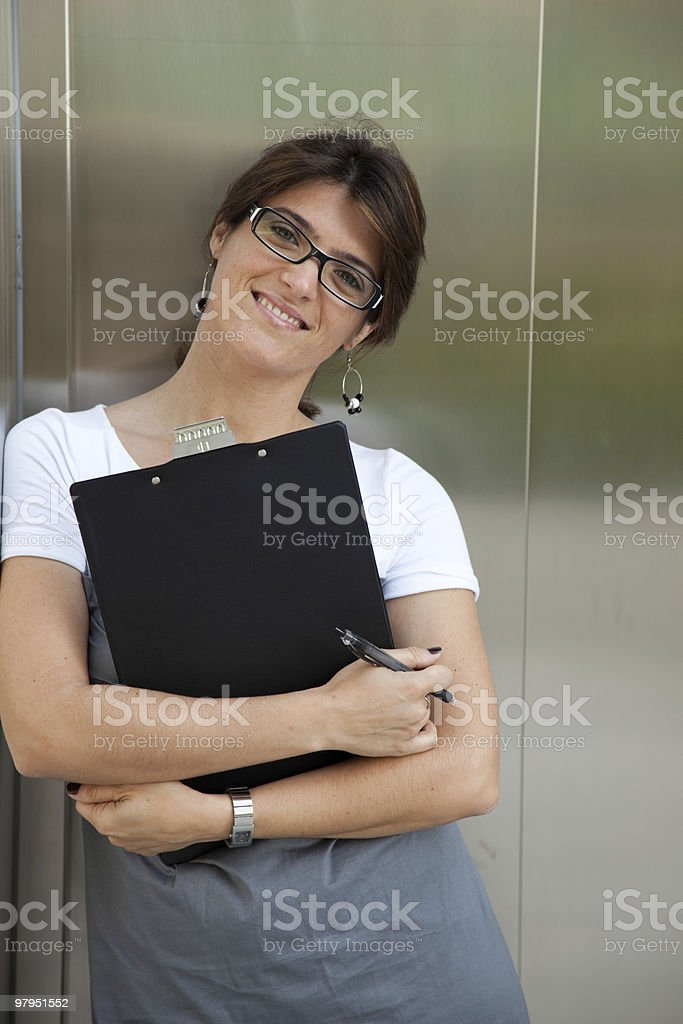 Businesswoman next to the elevator royalty-free stock photo