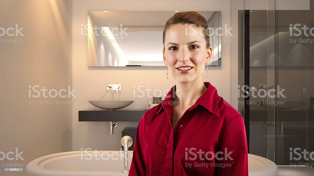 Businesswoman of a Realtor in a Model Bathroom stock photo
