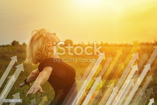 istock Businesswoman on a background of soaring arrows. 1023692060