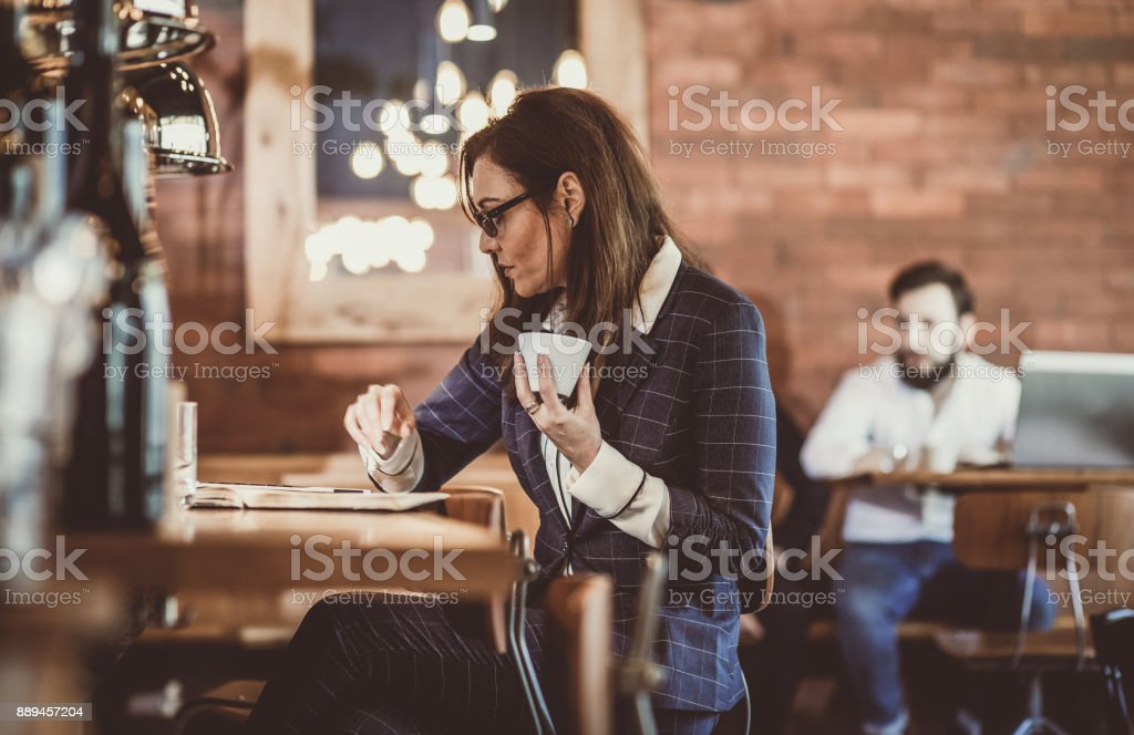 Businesswoman on a Break in The Cafeteria