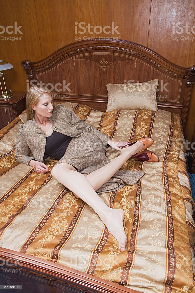 Hotel Room Photography: Businesswoman On Bed In Hotel Room Stock Photo