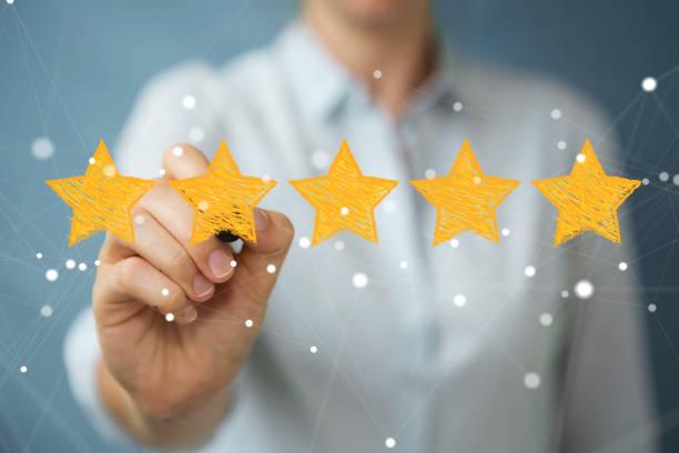 businesswoman on blurred background rating with hand drawn stars - evaluation zdjęcia i obrazy z banku zdjęć