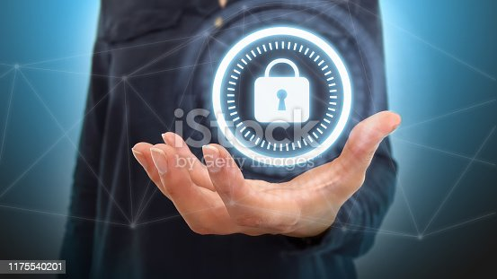 istock Businesswoman on blurred background using digital padlock security interface to protect datas 1175540201