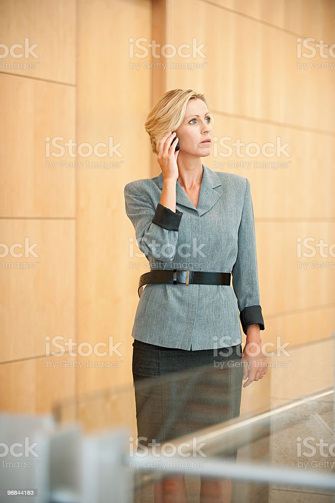 Businesswoman on cellphone royalty-free stock photo