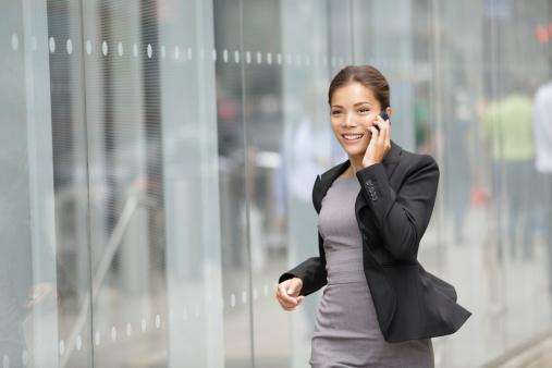 istock Businesswoman on cellphone running 177504731