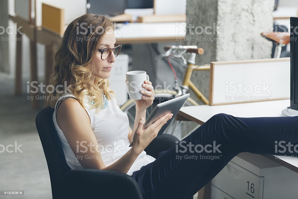 Businesswoman on coffee break in office. stock photo