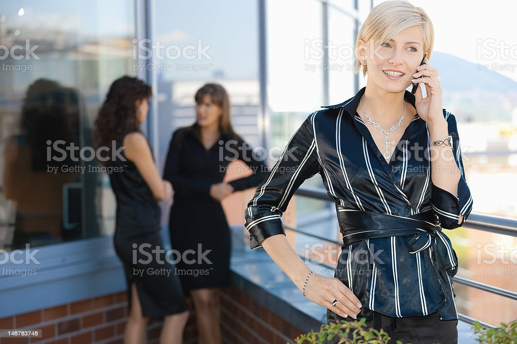 Businesswoman on mobile royalty-free stock photo