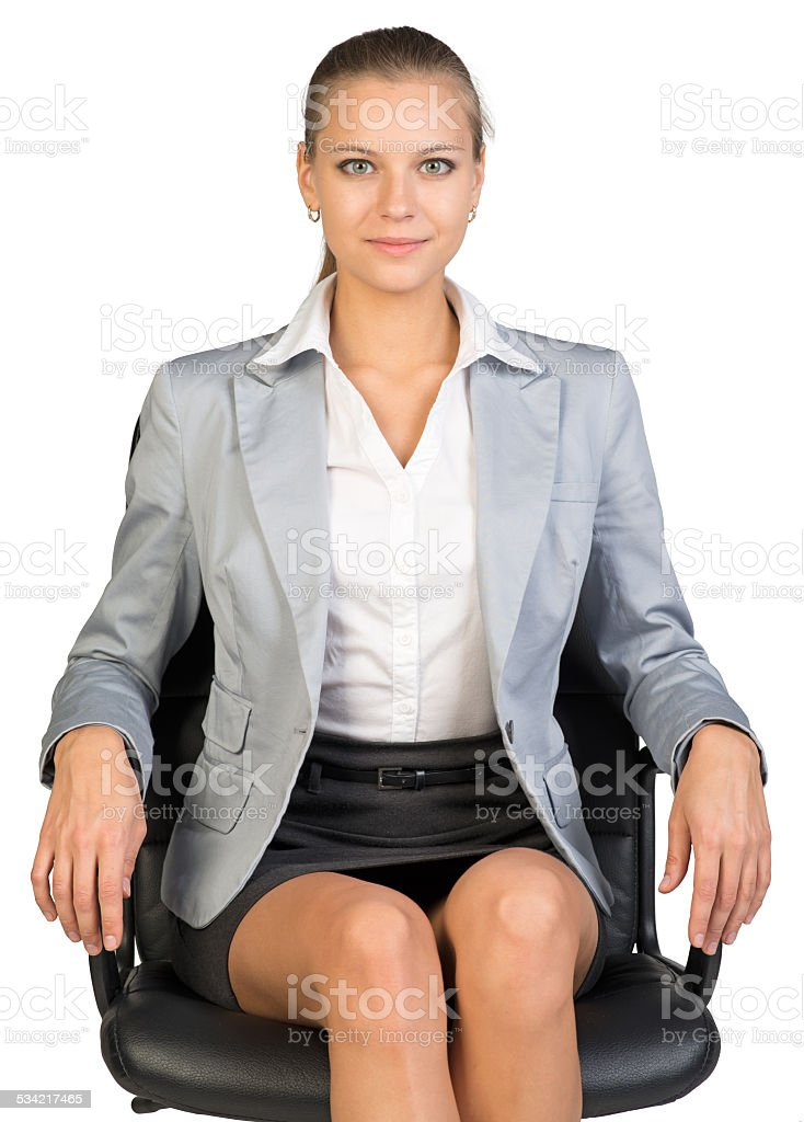 Businesswoman on office chair stock photo