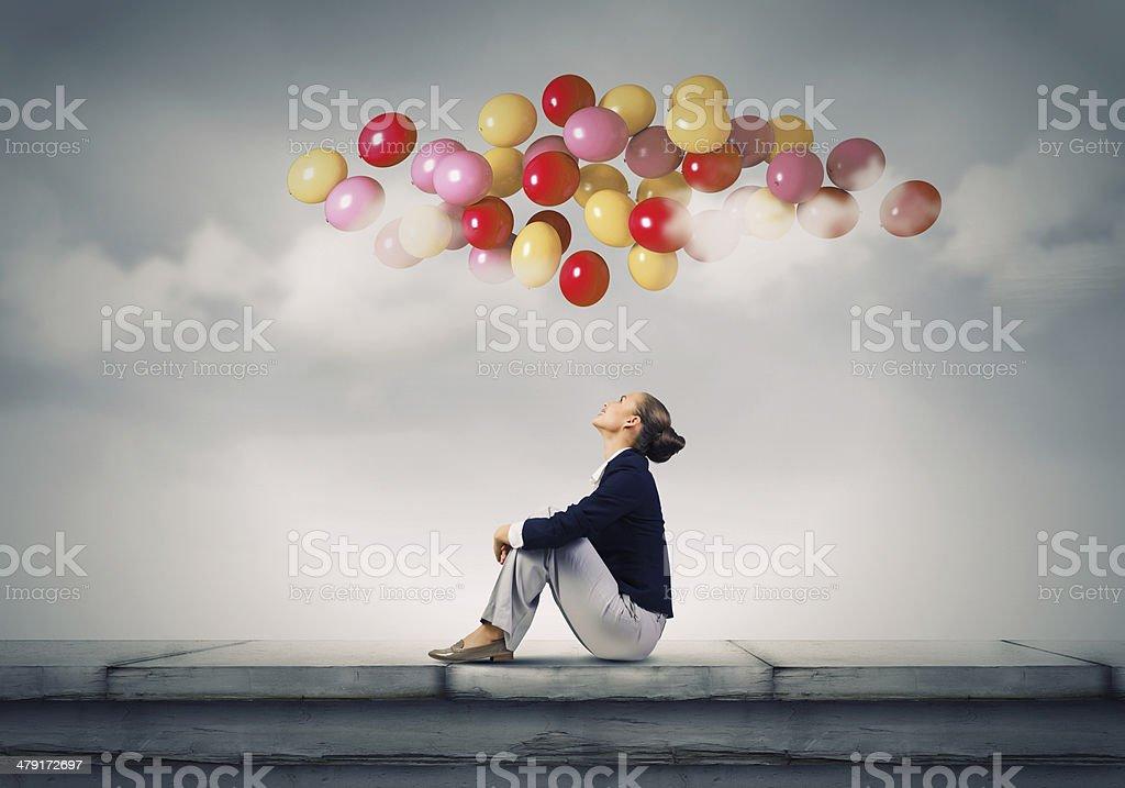 Businesswoman on roof stock photo
