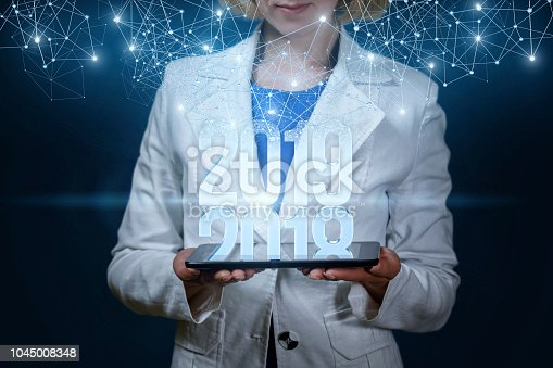 istock Businesswoman on tablet shows 2019 . 1045008348