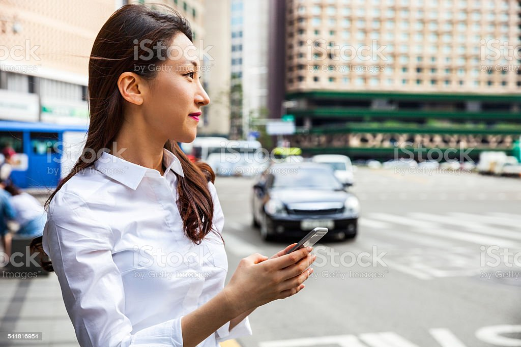 Businesswoman on the move in Seoul stock photo