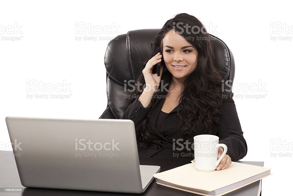 businesswoman on the phone at her desk royalty-free stock photo