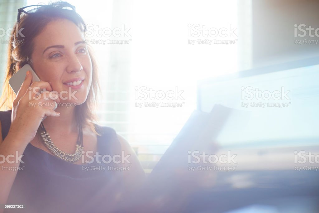 Businesswoman on the phone stock photo
