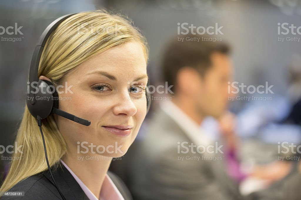 Businesswoman on the phone with headset at office stock photo
