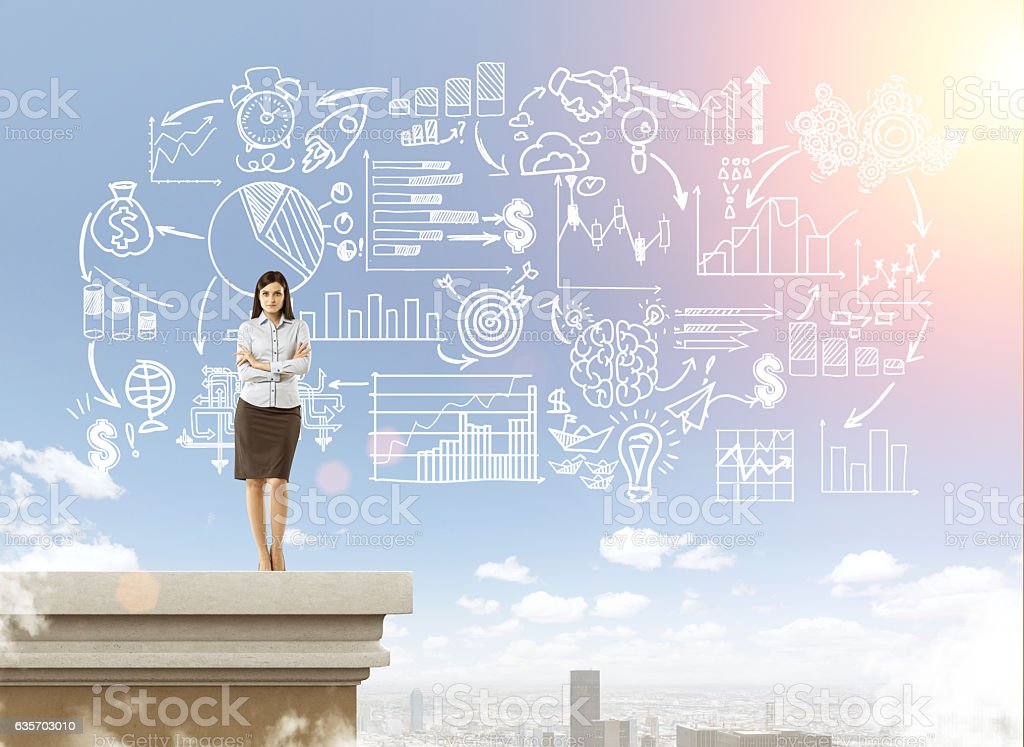 Businesswoman on the rooftop near business sketch royalty-free stock photo