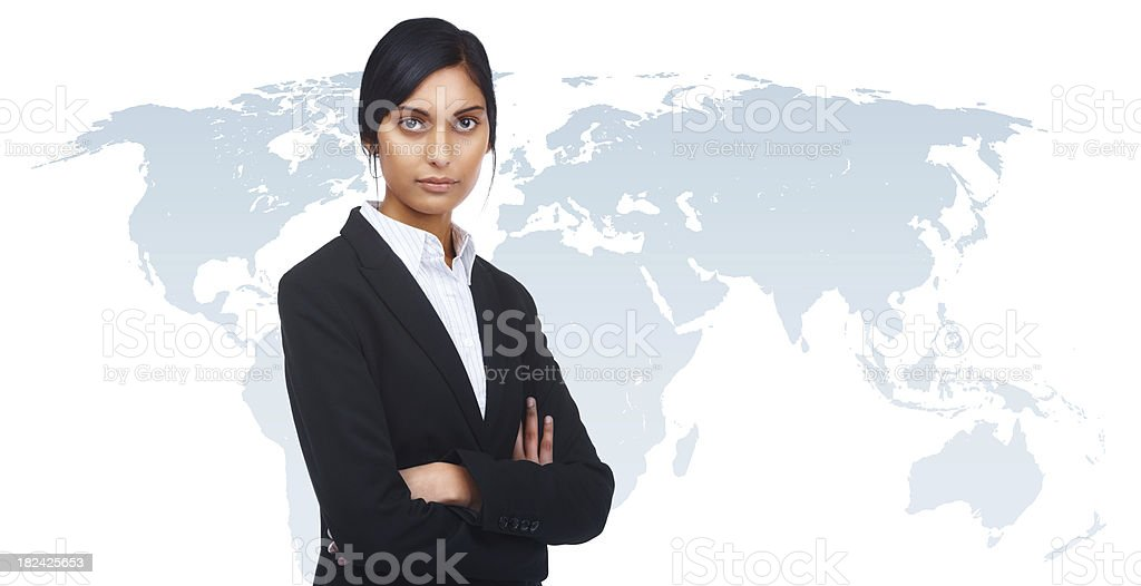 Businesswoman on top of the world royalty-free stock photo