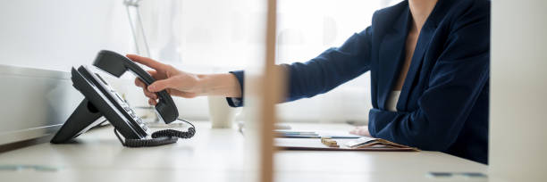 businesswoman or picking or hanging up  handset - cornetta telefono foto e immagini stock
