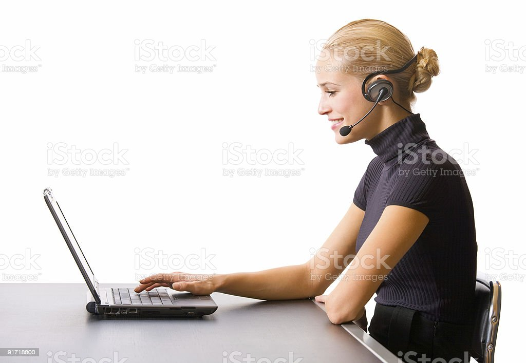 Businesswoman or secretary with headset and laptop at office, isolated royalty-free stock photo