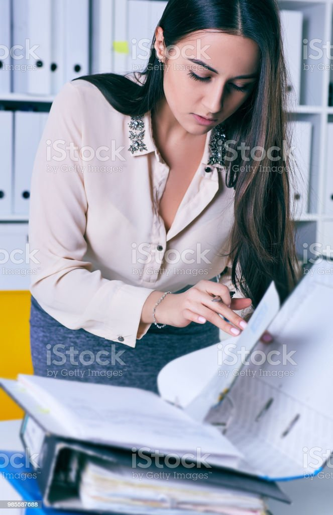 Businesswoman Or Secretary Working With Many Documents In Folders On