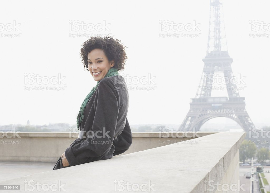 Businesswoman outdoors by Eiffel Tower royalty-free stock photo