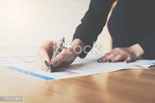 950986656istockphoto Businesswoman pen pointing graph chart in this mounth for Plans to improve quality next month. 1134127922