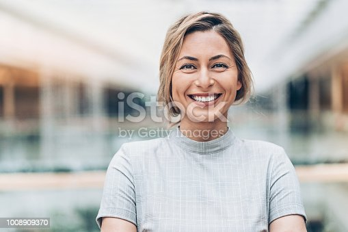Portrait of a smiling businesswoman looking at camera