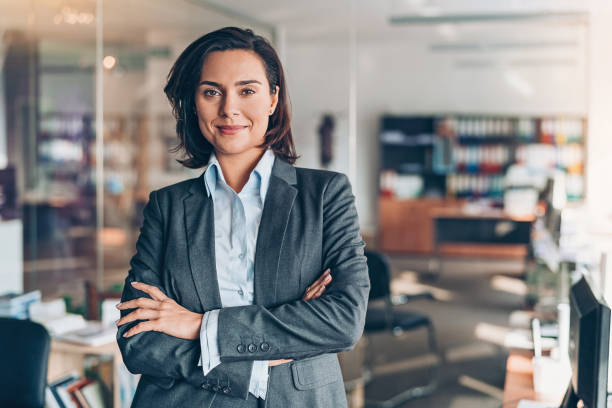 Businesswoman Portrait of a smiling young businesswoman in the office ceo stock pictures, royalty-free photos & images