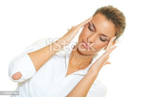 Closeup of young beautiful businesswoman with headache