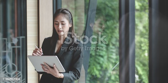 1068752548istockphoto Businesswoman planing her projects on tablet 1169852004
