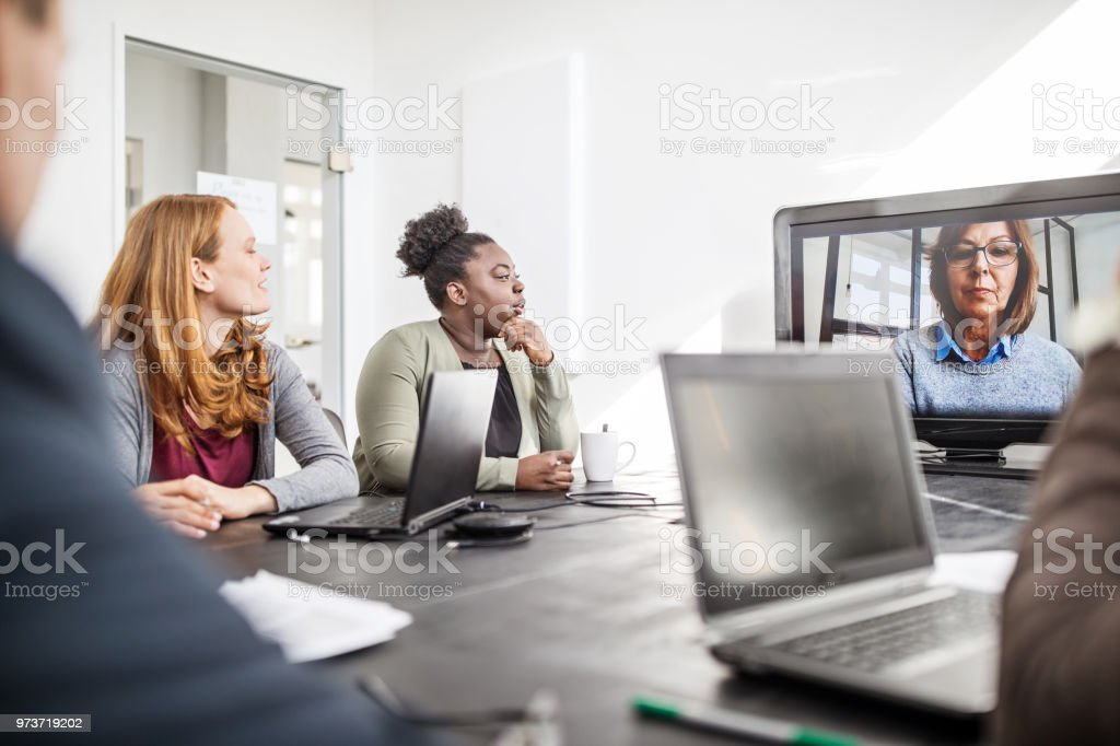 Businesswoman planning with coworkers on video call stock photo
