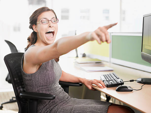 Businesswoman pointing and shouting stock photo
