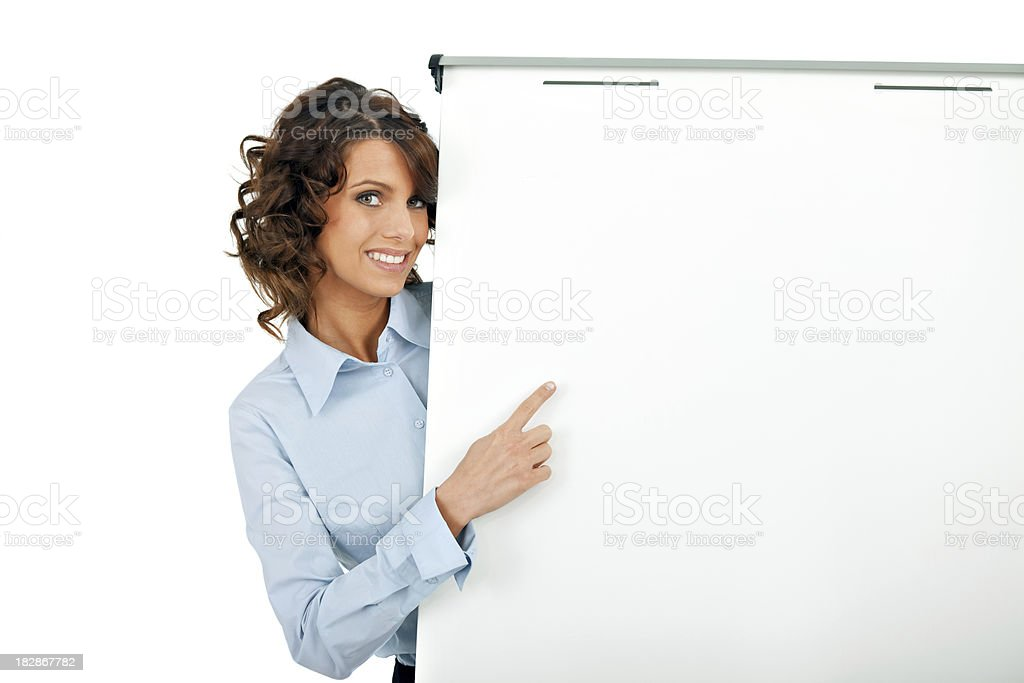 Businesswoman pointing at a white board royalty-free stock photo
