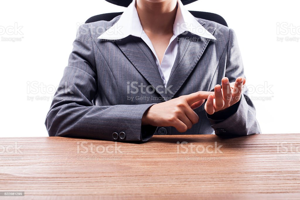 Businesswoman Pointing at Her Palm stock photo