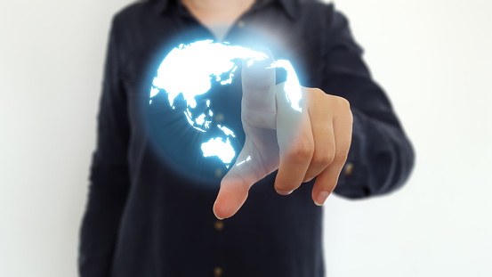 185274311 istock photo Businesswoman pointing finger on globe network hologram with America Usa map 1014508728