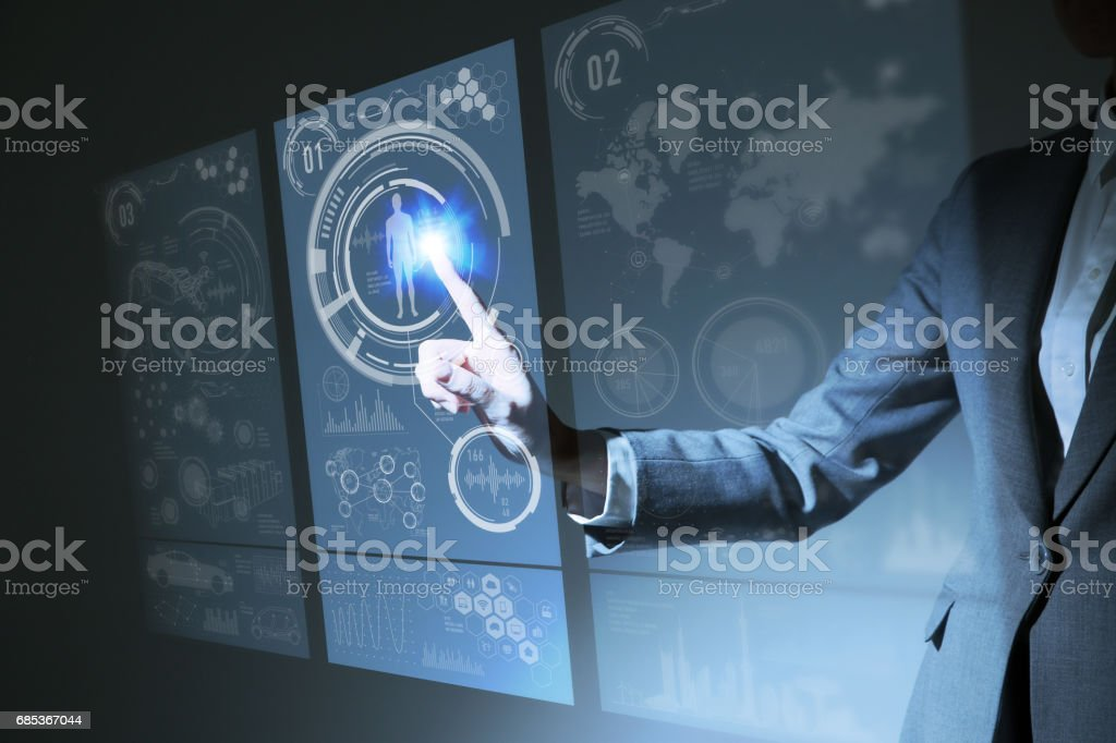 businesswoman pointing hologram interface, futuristic GUI(Graphical User Interface), IoT(Internet of Things), technological abstract stock photo