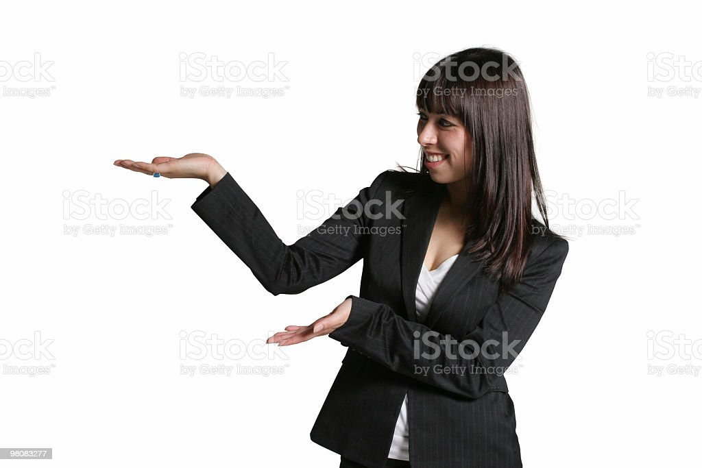Businesswoman pointing left royalty-free stock photo