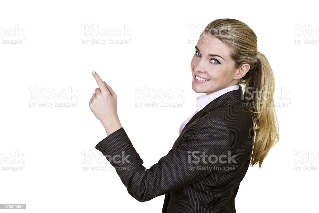 Businesswoman pointing to copy space stock photo